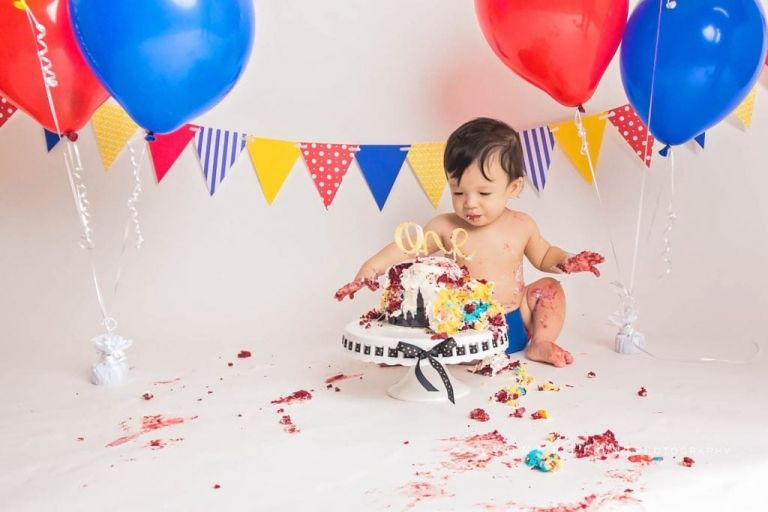 cake all over the floor and baby boy during a cake smash in nj photo studio, messy cake smash