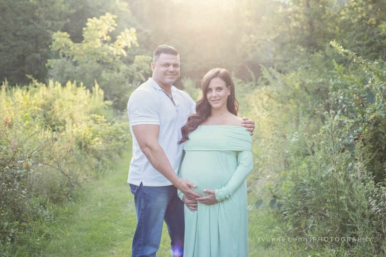 Couple Standing In The Sunlight During A Romantic NJ Maternity Photo Session At Sunset