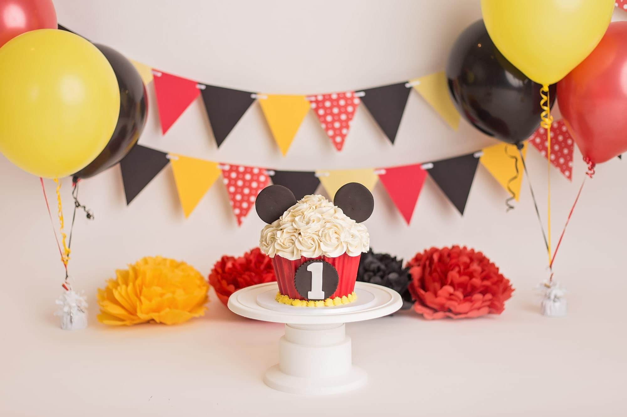props and setup for a mickey mouse cake smash photo session