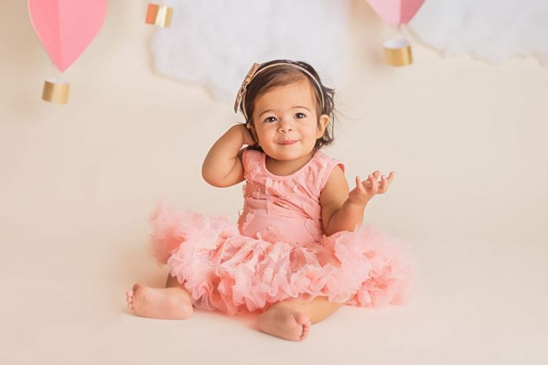 baby girl in a tutu dress for a first year baby photography portrait session