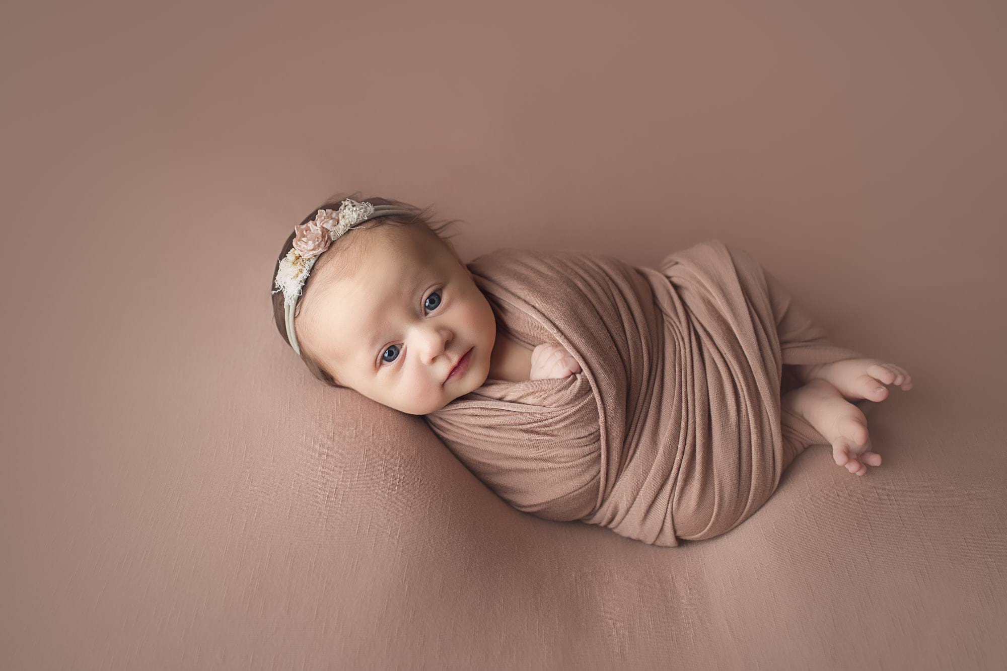 Photographing older newborns in a studio session