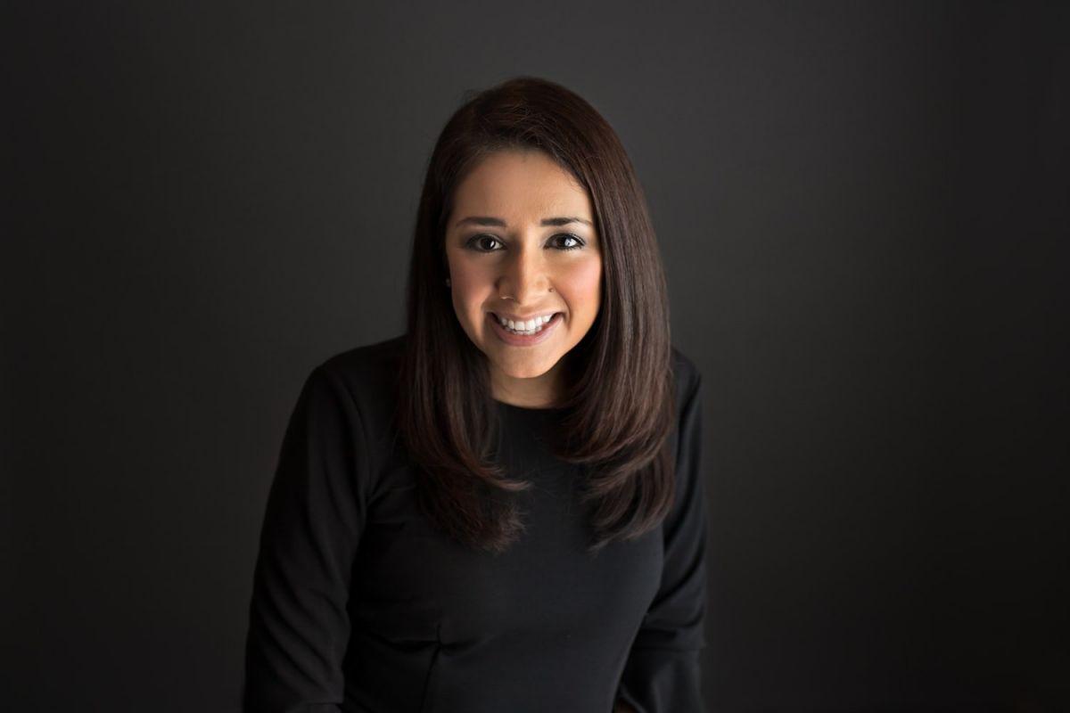 Headshot of NJ Photographer Yvonne Leon Photography; studio portrait on Thunder Grey
