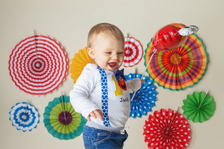 laughing baby boy during a first birthday photo session