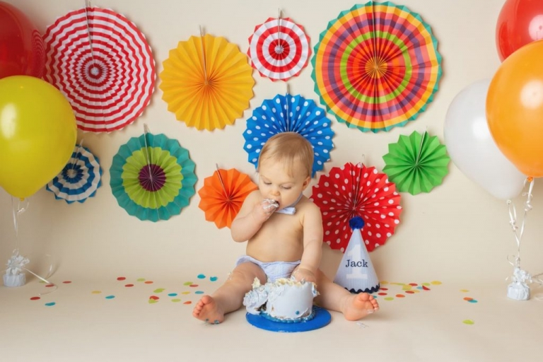 baby boy eating cake during his first birthday photoshoot by Yvonne Leon Photography
