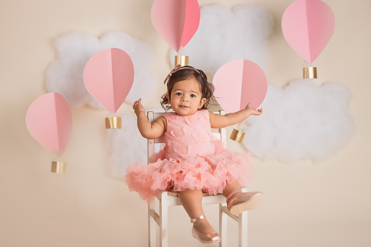 Hot Air Balloon cake smash photo session for a baby girl! Pink, sweet, and cute!