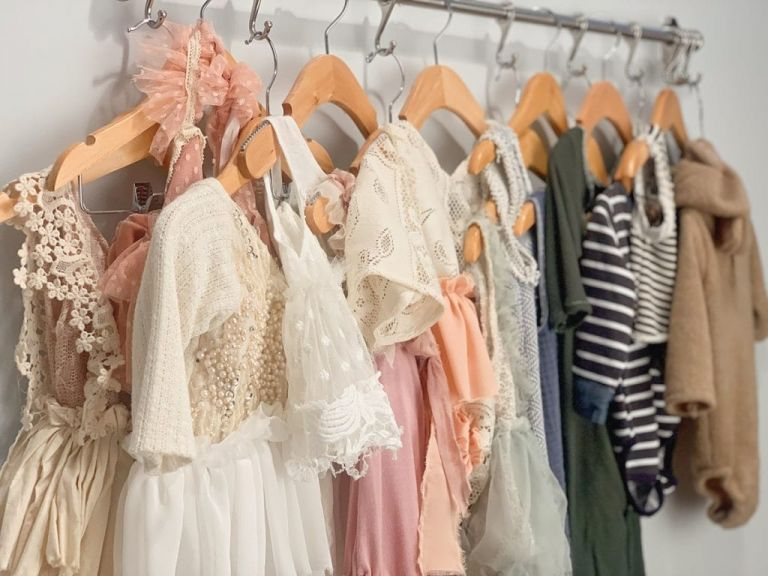 A rack of baby clothes at the studio of Yvonne Leon Photography in New Jersey.