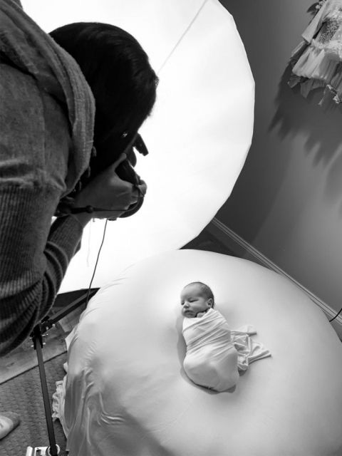 New Jersey photographer Yvonne Leon working in a newborn photo session