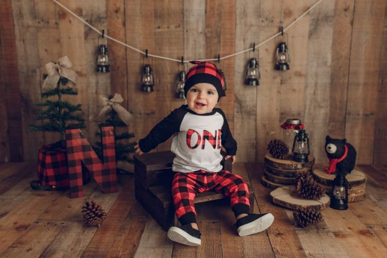 smiling baby in a rustic winter cake smash session at Yvonne Leon Photography studio.
