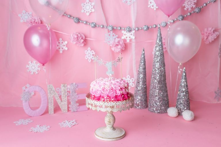 beautiful and sparkly props for a winter onederland cake smash for a baby girl.
